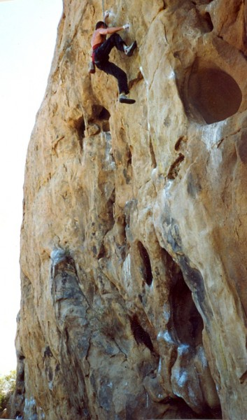 "Peter Hayes entering the crux of ""Vicious"", 5.12-, to the right of ""A ..."