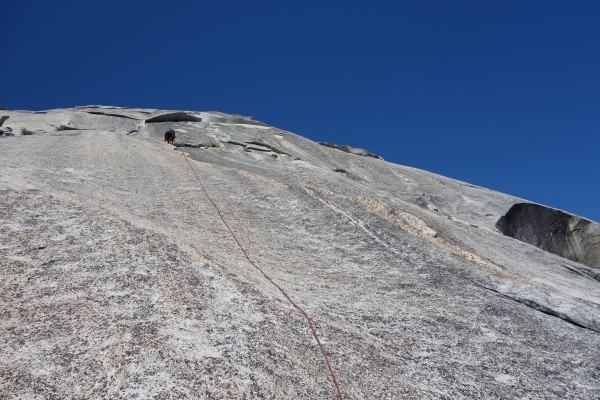 Pitch 6, climbing cracks that are to the right of the anchor
