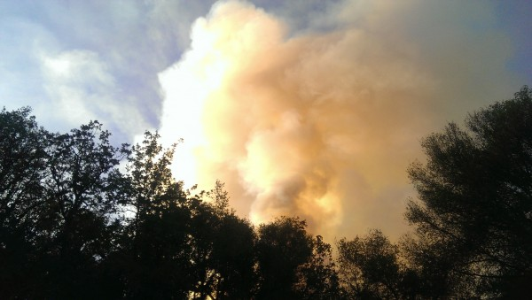 Looking north from our driveway. The fire is just over the ridge. An e...