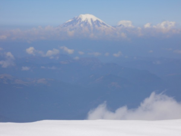 The white summit of Rainier above the smoke