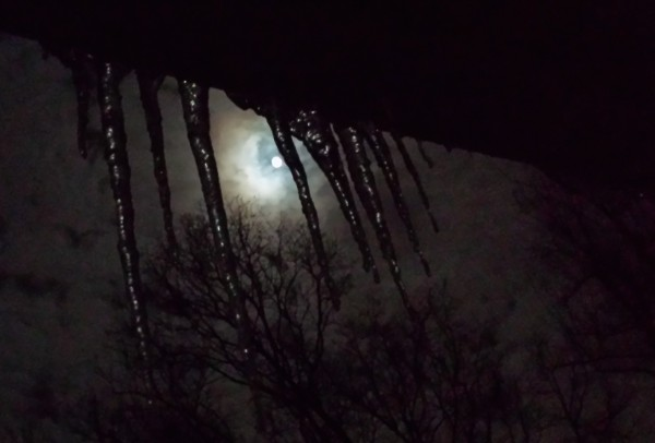 Full moon through icicles