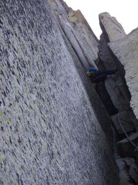 Lukasz chimneying through the 5.7 section. Placed the backpack on the ...