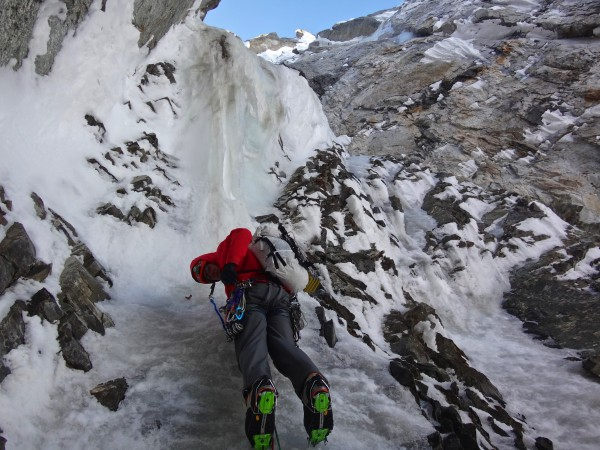 An overhanging wave of snice in the north couloir, still 3400 feet bel...