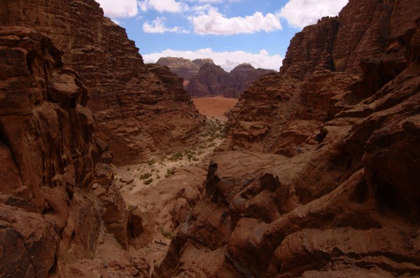 Rakabat Canyon with the dunes of Wadi Um Ishrin in the distance.