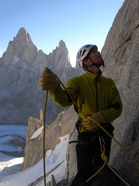 Belaying on Cerro Torre with Fitz Roy in the background.