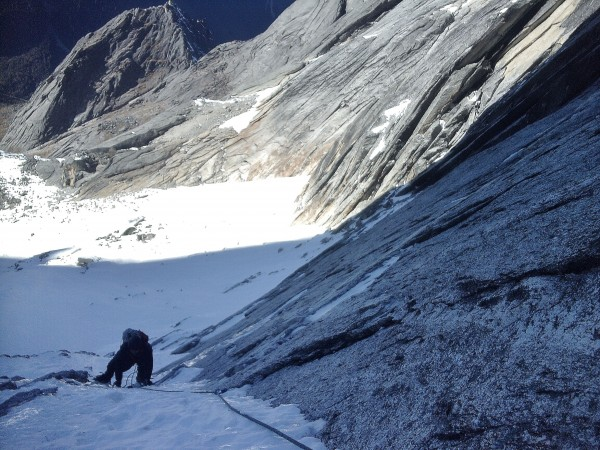 beyond the traverse the angle got steeper and the sheet of snow over t...