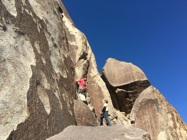 Photo credit goes to Skip.   Starting a 5.10 hand crack.
