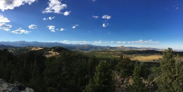 Longs Peak at center, Boulder at far right.