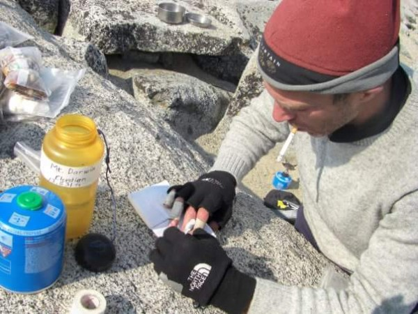 Scott making a new summit register on Darwin