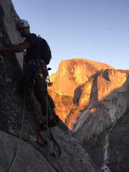 Todd leading away from the 10th anchor as the sun sets on Half Dome.