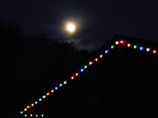 On the front deck watching the moon rise and Christmas lights come on....