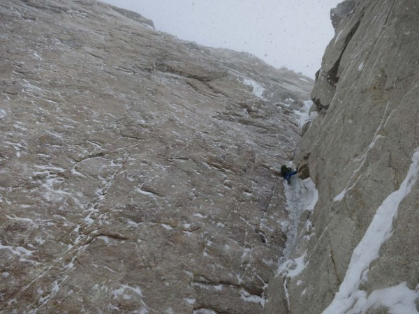 Nick on the classic steep ice pitch of the corner, with the big granit...
