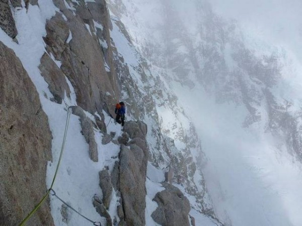 On the long traverse pitch above the rock band (photo – Nick Bullo...