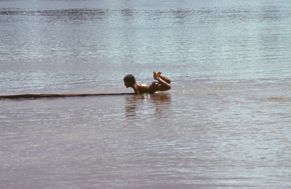 Boy on his log....Orinoco River