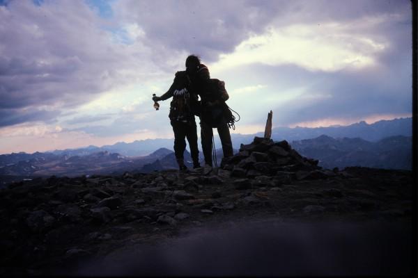 The summiteers on the summit doing summit celebratory things.