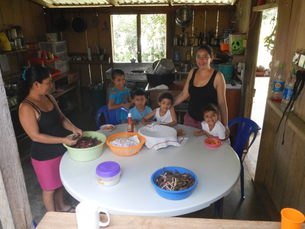 Blanca and family pealing beans