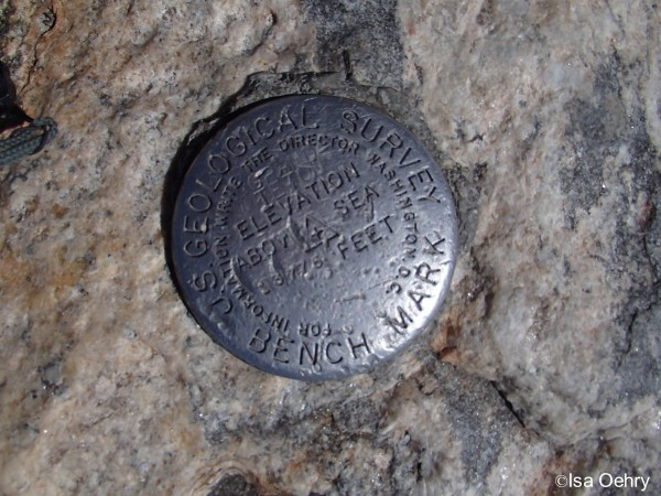 The Benchmark on the summit of the Grand