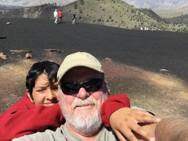 Grandson Isaac looking over papa's shoulder in Craters of the Moon Nat...
