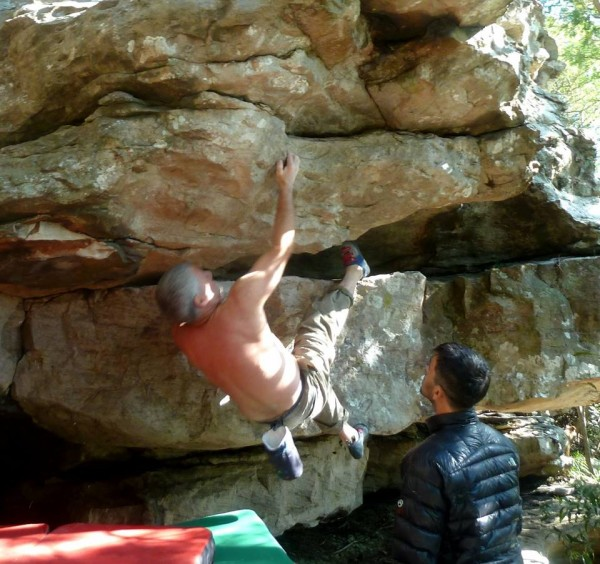 Old guy climbs moderate boulder