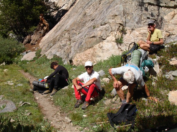 L to R: Son, father, Lowe, Donini on phone. On hike to Lamarck Col.
