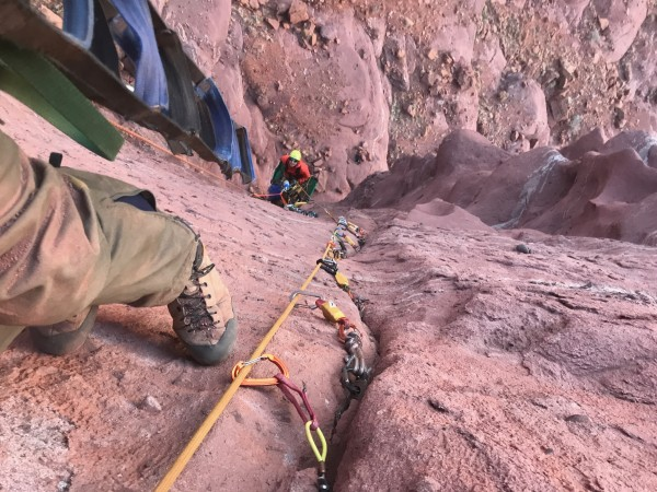 Excavating pitch three while Keiko is at the belay on John Middendorf'...