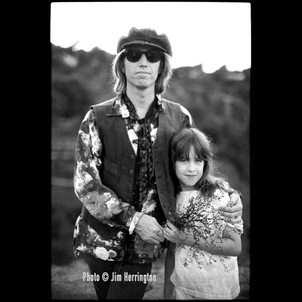 Tom Petty and his daughter, 1989.  <br/> Photo &copy; Jim Herrington