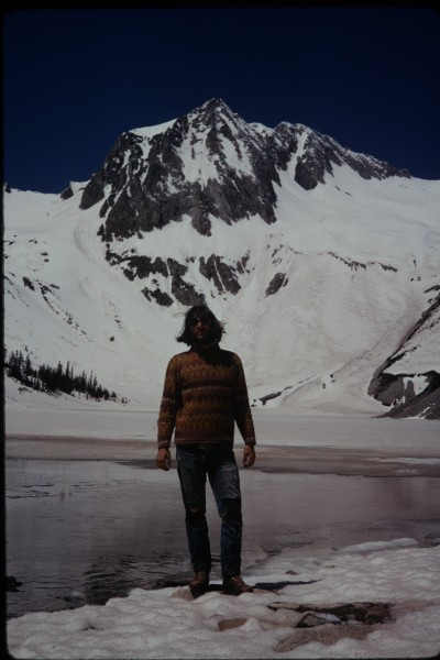 Charlie at Snowmass Lake, with the prominent east face of Hagerman Pea...