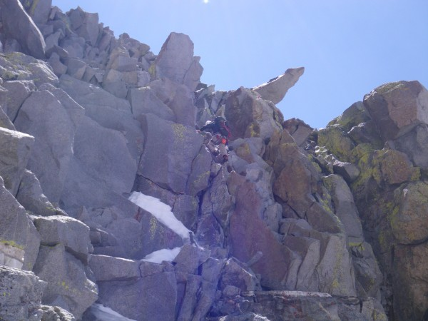 Justin downclimbing the short fourth class near the rap slings (we did...