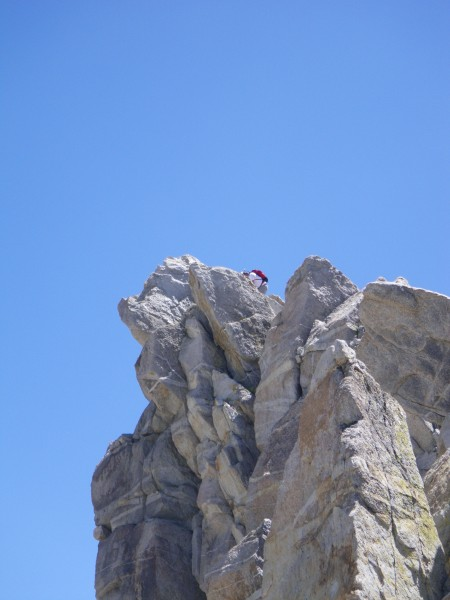 Peakbagger on true summit of Matterhorn, as viewed from top of North A...