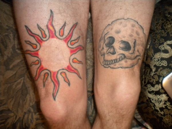Melnoma removal scar on right leg, Skull in moon on left leg. Where it...