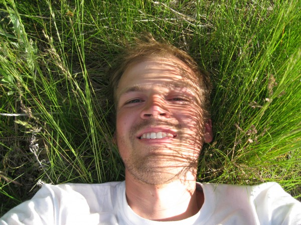 Soaking up some sunshine in the meadows... see the mosquito eating my ...