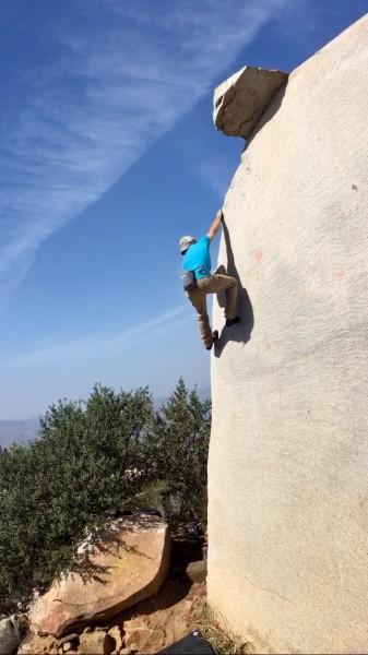 Ben bouldering 'Cataclysm Arete'