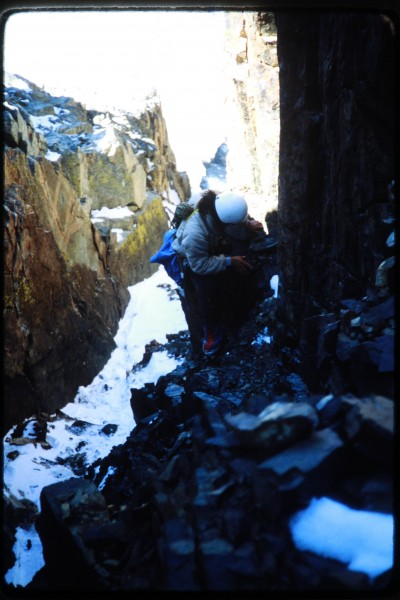 Jimmy scrambling up the rock near the top of the couloir.