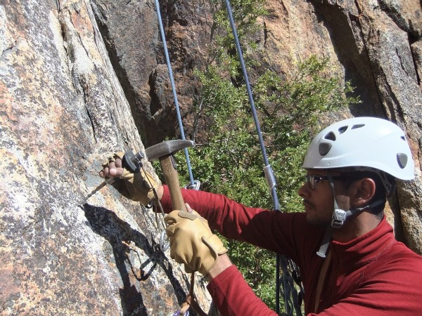 Job drilling anchor #5 on the Middle Cathedral East Face rap route, <br/>