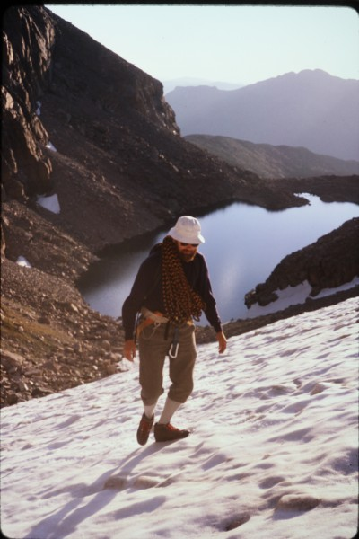 John approaching the base of Stettners Ledges across the snow field at...