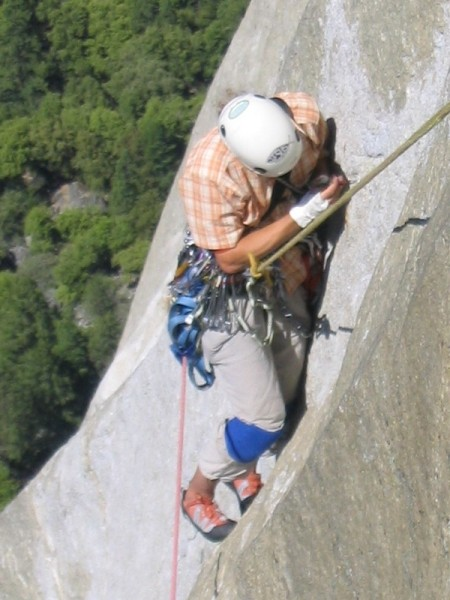 Johan Hvenmark trying to place some gear in a tiny shallow crack, King...