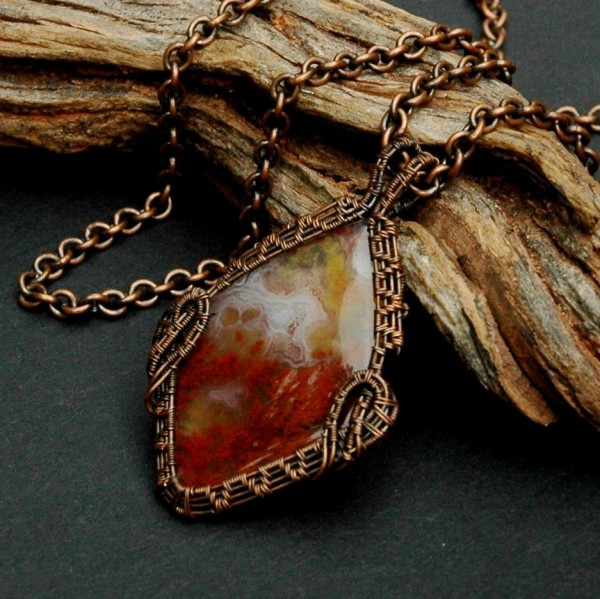 A Carey Plume Agate cabochon; a stone mined in the 1950's at the Carey...