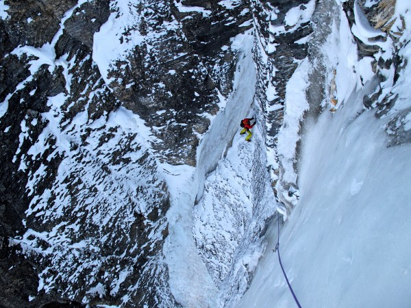 Leaving an ankle-wrenching belay on sixty-degree ice, Juan Henriquez s...