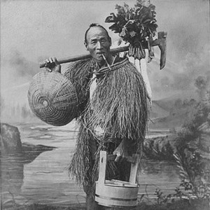 1896 photo of a raincoat clad Japanese farmer
