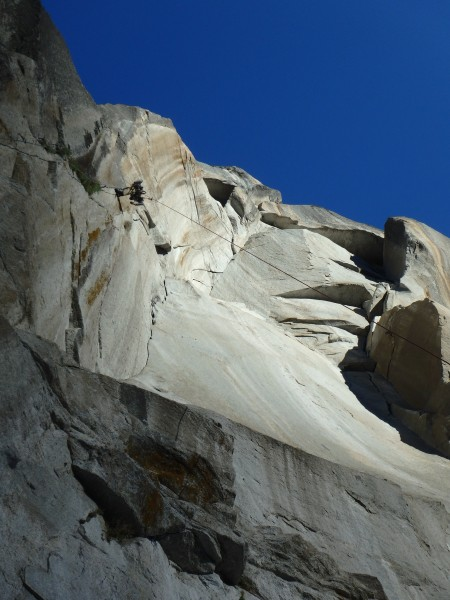Climbing into the morning rays over Half Dome near the top of the Colu...