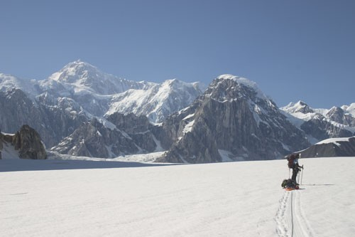Joe Puryear on the Ruth Glacier with Denali in the background.