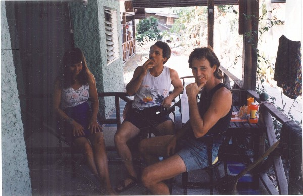 Jean Scott, Johnny, and Tom Cecil enjoy some Cambodian in front of our...