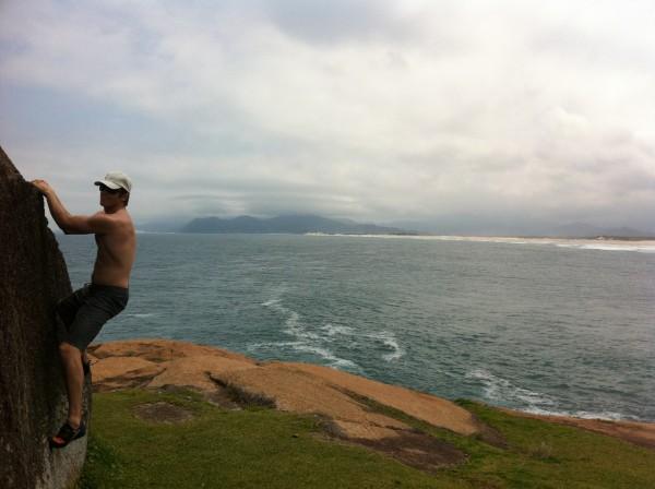 Chris McNamara bouldering at Guarda Brazil above a great surf break.