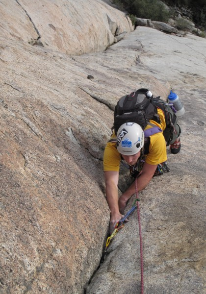 Coby Jamming the Tollhouse Traverse - pitch 1.