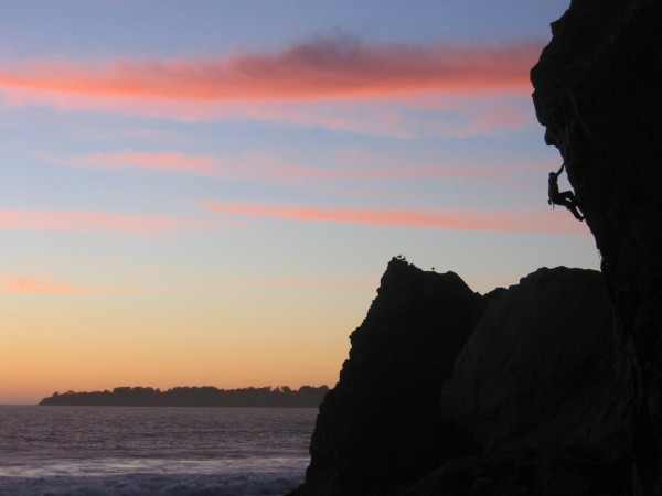 Charlie Barret does a sunset lap on Courtney (5.12a) at Mickey's Beach...