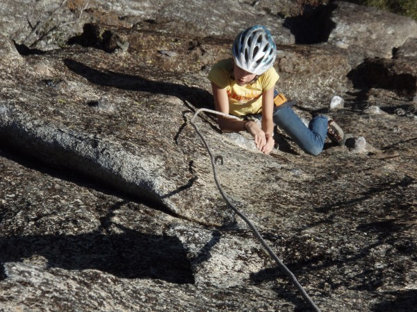 makayla crank'in 5.10 on the headwall
