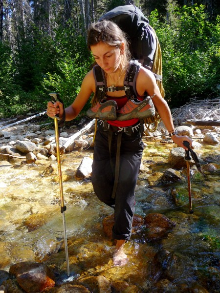 Rebecca Schroeder crossing the frigid Early Winters Creek below the Wi...