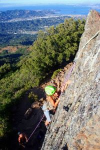 "Holly Anne Grinnell climbs the ""East Slab"" (5.6) on the north-..."