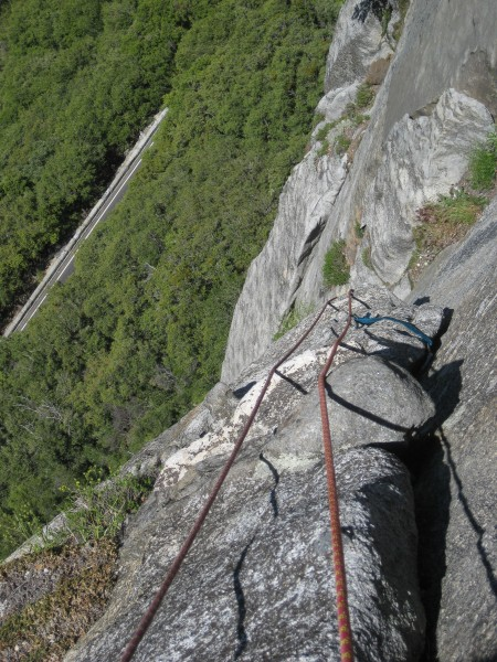 Looking back while nearing the top of pitch 3.