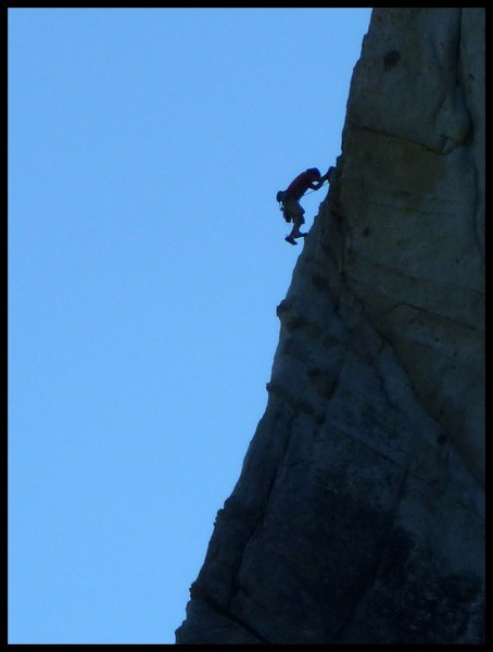 Unknown climber clearing the classic arete on Traveler's Buttress